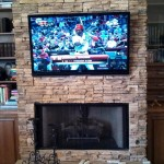 Flat panel TV hung on Cultured stone fireplace