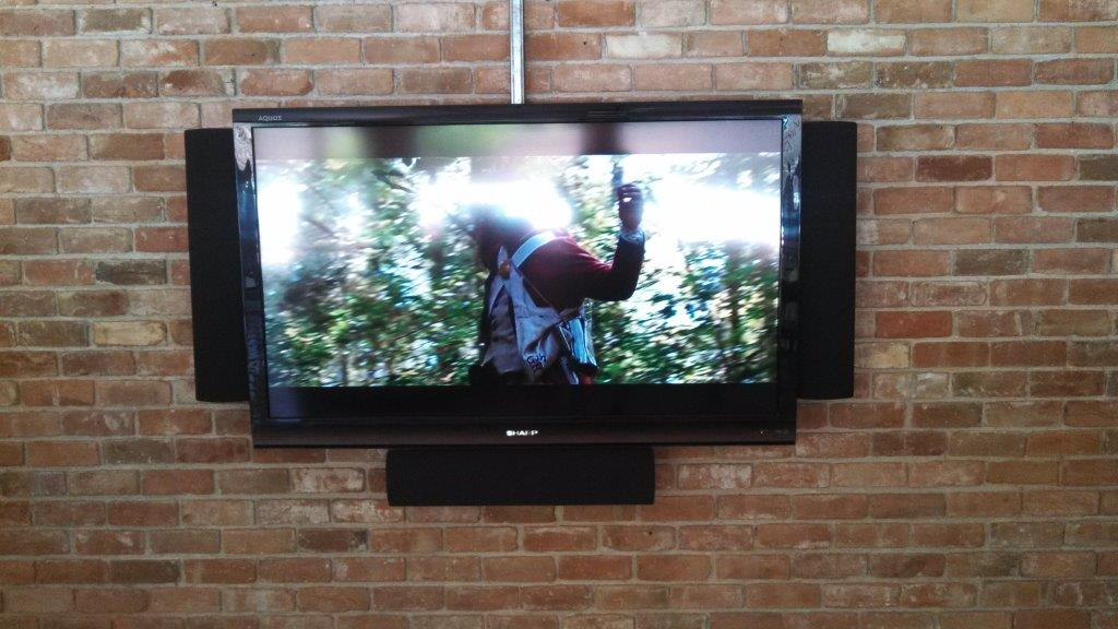 60 inch Sharp mounted on brick